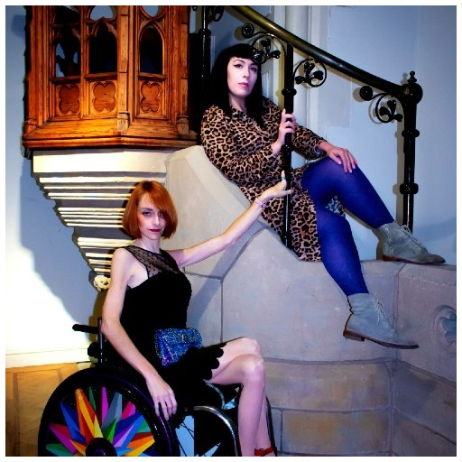 Clare McNulty is draped on a chruch stairway whilst Natalie Amber hold onto the bannister from her wheelchair