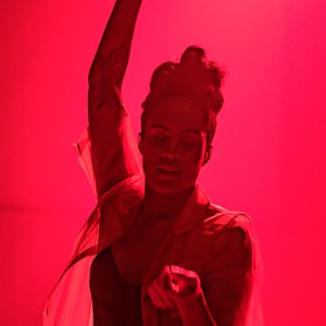 Alexandrina Hemsley dances amidst a room filled with red light