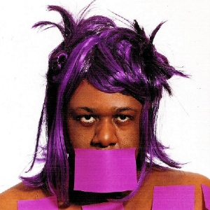 Artist Deborah Williams with purple sticky notes on her body